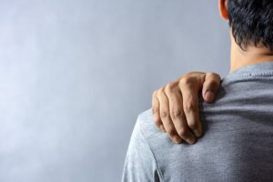 Patient holding shoulder in pain